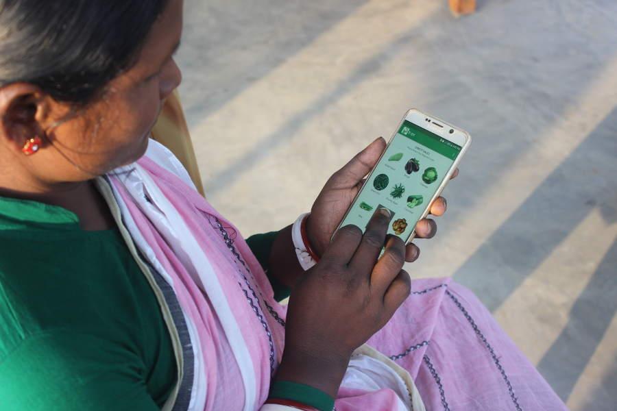 Rural woman using eFarmersHub mobile application